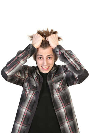 Stressed young man tear his hair out, crazy face expression on the white background Stock Photo - 19202352