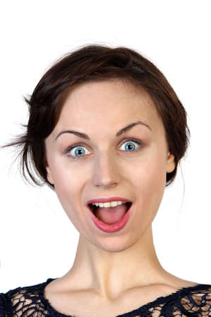 women face stare: Young woman with surprised expression on white background Stock Photo
