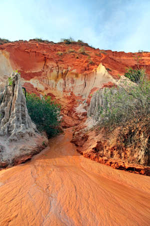 Ham Tien canyon in Vietnam, small stream carving through the sand photo