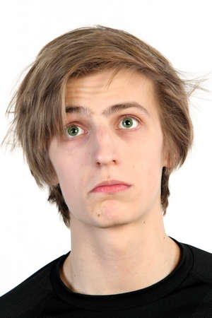 Young caucasian man frustrated with something, on white background photo