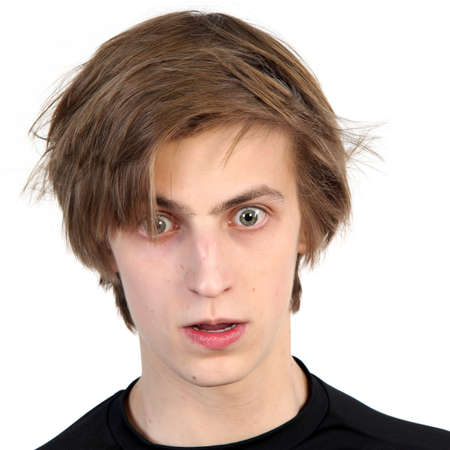 scared man: Young caucasian man with amazed scared face expression,  on white background Stock Photo