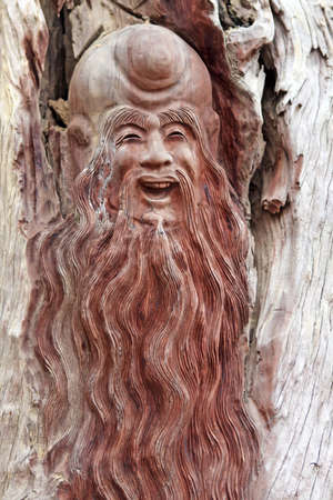 bas relief: Wooden  bas relief of asian long-haired man