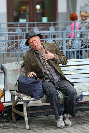 heartache: Lonely old homeless man with heartache on th street