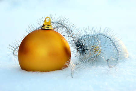 Golden and silver christmas balls  in snow Stock Photo