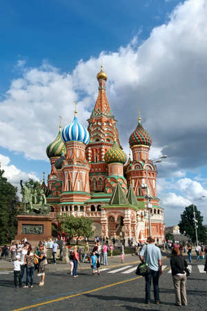 vasily: MOSCOW, RUSSIA -JULY 5, 2014  Tourists visiting St  Basil Cathedral on  Red Square on july 13, 2014  in Moscow, Russia