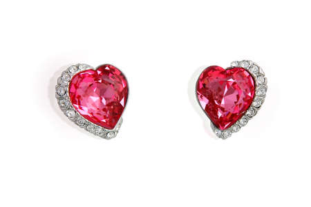 Earrings in the shape of heart isolated on white background