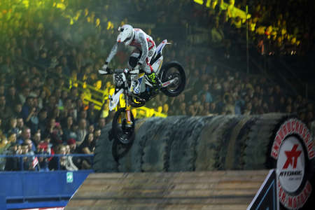 sports complex: RUSSIA, MOSCOW-MARCH 14: A professional rider at the FMX (Freestyle Motocross)  doing tricks on his ATV at the VIII festival of extreme sports in Olympic Sports Complex Moscow, Russia, on March 14, 2015
