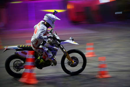 olympic sports: RUSSIA, MOSCOW-MARCH 14: A professional rider at the FMX (Freestyle Motocross)  doing tricks on his ATV at the VIII festival of extreme sports in Olympic Sports Complex Moscow, Russia, on March 14, 2015