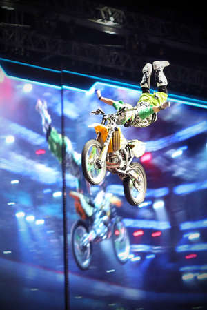 olympic sports: RUSSIA, MOSCOW-MARCH 14: A professional rider at the FMX (Freestyle Motocross) doing tricks on his ATV at the VIII festival of extreme sports in Olympic Sports Complex Moscow, Russia, on March 14, 2015 Editorial