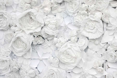 decorative background from white paper flowers of a paper-mache