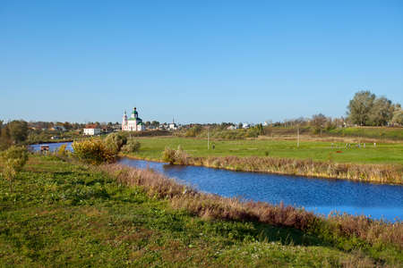 golden ring: Russian landscape with river Kamenka and Church in Suzdal. Golden Ring of Russia Stock Photo