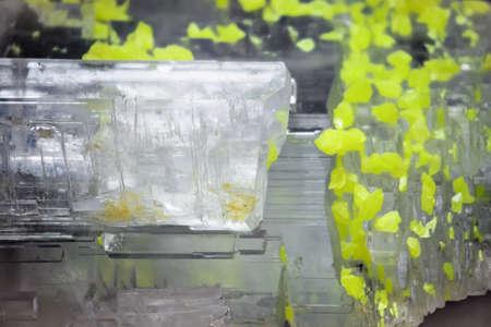 lamellar: Natural mineral stone- sulphatic sulfur. Crystal of native sulfur in plaster