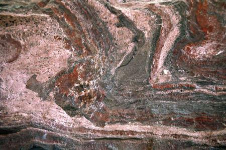 gemology: Natural rock background - gemstone of ferruginous quartzite -  hematite in calcite and  jasper