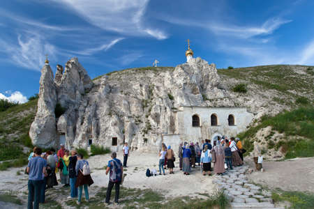 voronezh: DIVNOGORIE, VORONEZH REGION, RUSSIA - JUNE 12, 2016: People near the Orthodox cathedral carved out of natural rock, Russia, Voronezh region, museum Divnogorie, June 12, 2016 Editorial