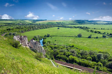 voronezh: Summer landscape with river,  railway and cave temple in Divnogorsky Sacred Uspenskom a mans monastery. Voronezh region. Russia Stock Photo