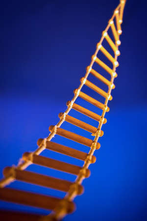 rope ladder: Rope ladder for climbing to top on blue background