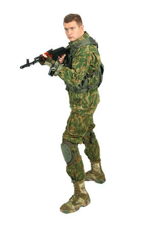 serviceman: Military serviceman with rifle. Isolated on white background