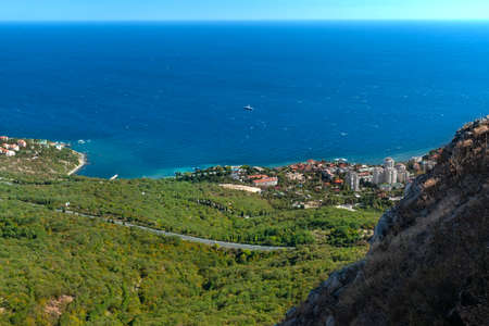 View from the Red Cliff on the town of Foros to coast of the Black Sea. Crimean mountains.