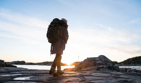 Sunset Girl in south Norway Stock Photo