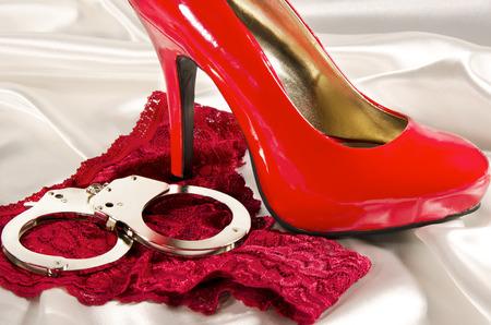 Handcuffs and high heel Stockfoto
