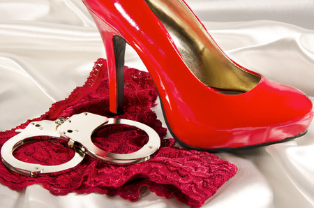 Handcuffs and high heel 免版税图像