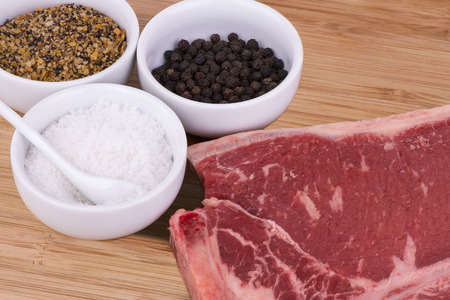 T-bone with seasoning Stock Photo