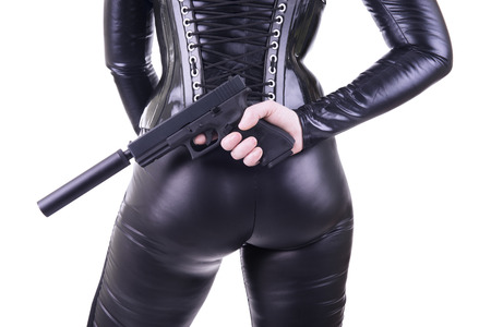 assassin: Sexy woman with gun.