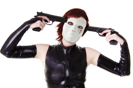 tendencies: Young masked woman with guns. Stock Photo