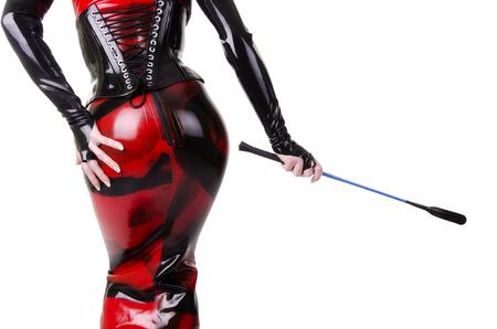 Woman dressed in dominatrix clothes Standard-Bild
