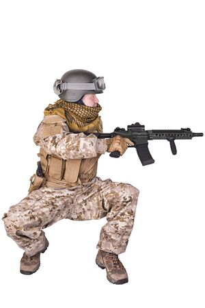 crouching: Army soldier crouching. Stock Photo