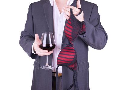 Businessman holding glass of wine and bra. Banco de Imagens