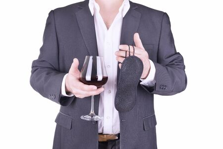 adult sex: Businessman holding glass of wine and blindfold.