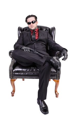 glock: Killer sitting on chair.