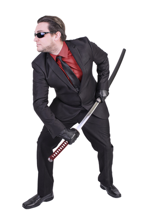 katana sword: Handsome man holding katana sword
