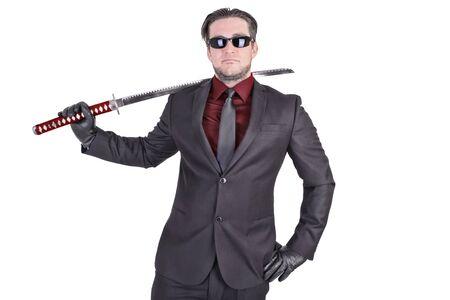 katana: Handsome man holding katana sword
