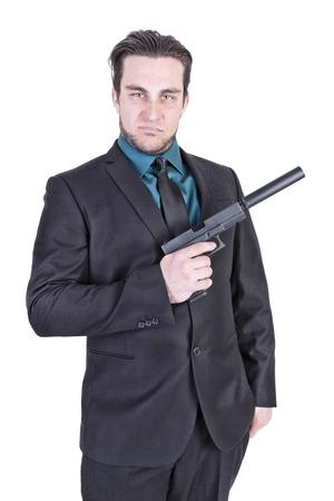 holding gun: Handsome man holding gun