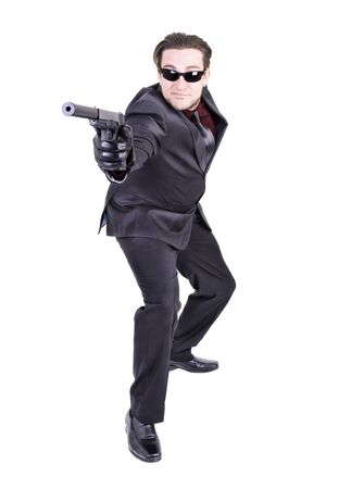 Elegant gangster ready to shoot, isolated on white background.