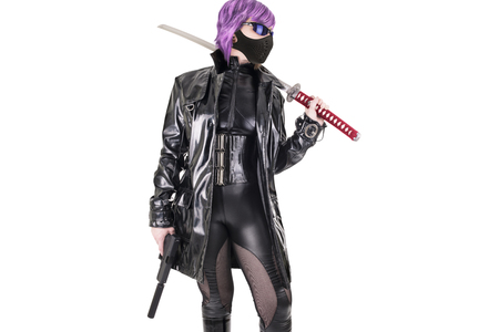 katana: Sexy woman holding katana and handgun. Isolated on white background.