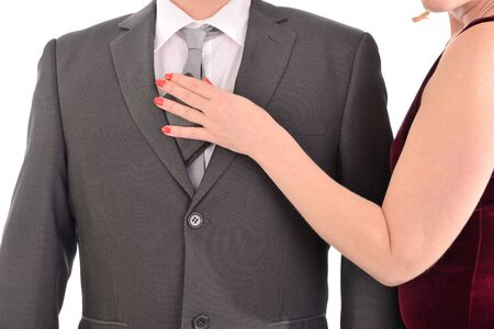 pickpocket: Woman pulls out wallet from a pocket of the businessman.  Isolated on white background. Stock Photo