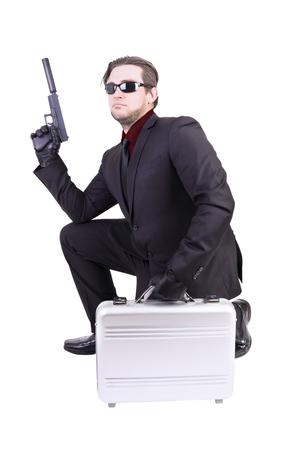 hitman: Elegant gangster holding gun, isolated on white background.