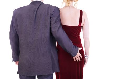 grabbing: Male grabbing female buttocks, sexual harassment concept. Stock Photo
