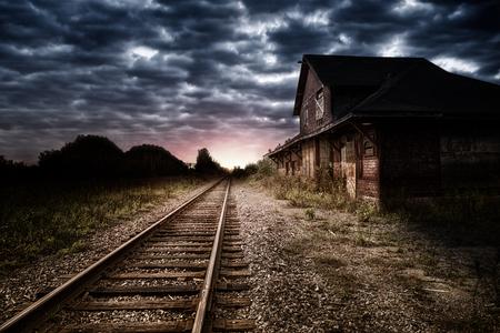 夜の空と放棄された駅 写真素材