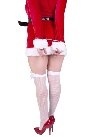 bondage girl: Beautiful sexy girl wearing santa claus clothes isolated on white background