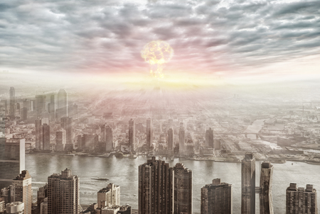 Aerial view of nuclear explosion over a city.