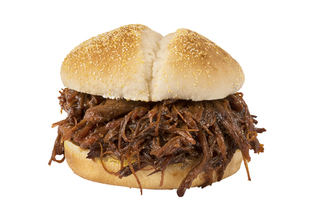Close up on pulled pork sandwich isolated on white background.