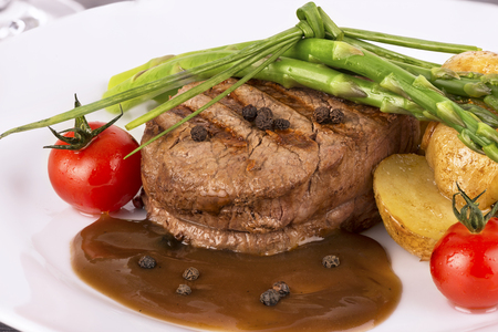 Close up on filet mignon with vegetables on the side Banco de Imagens