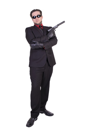 the silencer: Handsome man holding gun, isolated on white background. Stock Photo