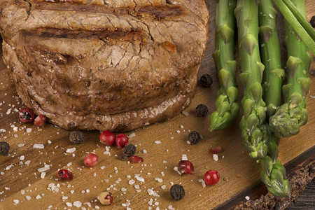 generosa: Close up on filet mignon with asparagus on the side.