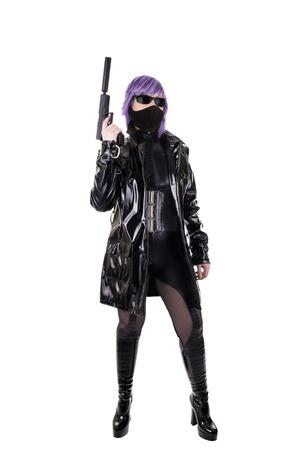 Sexy killer holding gun, isolated on white background.
