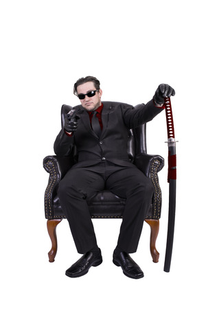 Killer sitting on chair, isolated on white background.